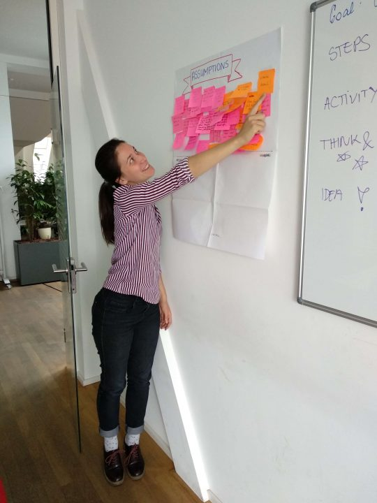 How to give design critique: researcher pointing to post-its
