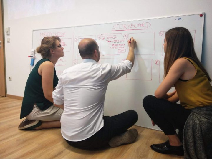 Design sprint team members storyboarding