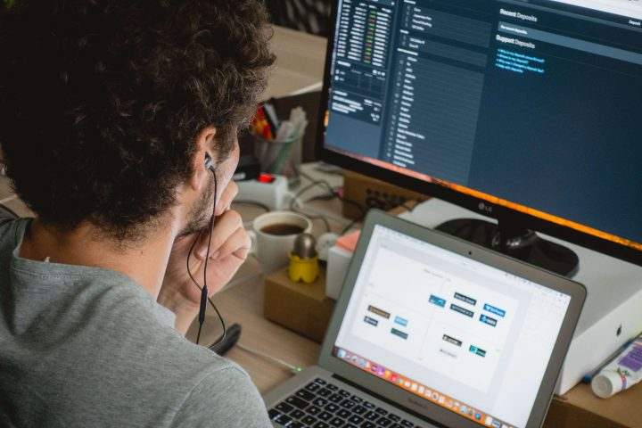 Outsource Web Design: Man working at a computer