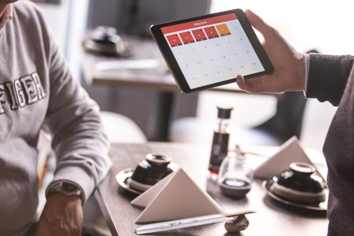 Service design: man holding a tablet