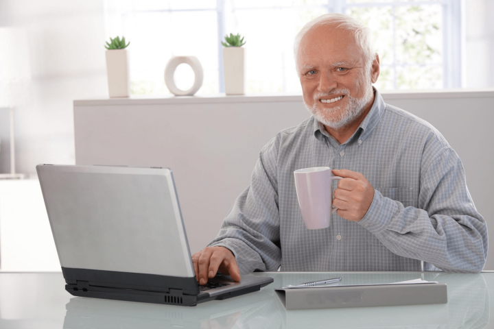 Harold learning how to use apps for seniors on his laptop