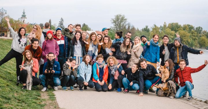 The 35-person UX studio team posing on the Danube shore in Szentendre in 2019